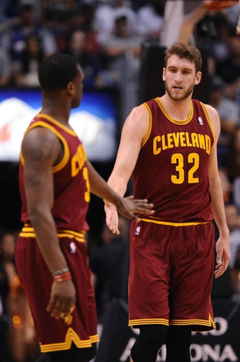 Mar 12, 2014; Phoenix, AZ, USA; Cleveland Cavaliers center Spencer Hawes (32) celebrates with guard Dion Waiters (3) in the first half against the Phoenix Suns at US Airways Center. Mandatory Credit: Jennifer Stewart-USA TODAY Sports