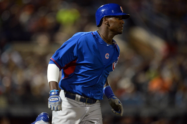 Mar 12, 2014; Peoria, AZ, USA; Chicago Cubs left fielder Junior Lake (21) runs first base after hitting a first inning single against the Seattle Mariners at Peoria Sports Complex. Mandatory Credit: Joe Camporeale-USA TODAY Sports