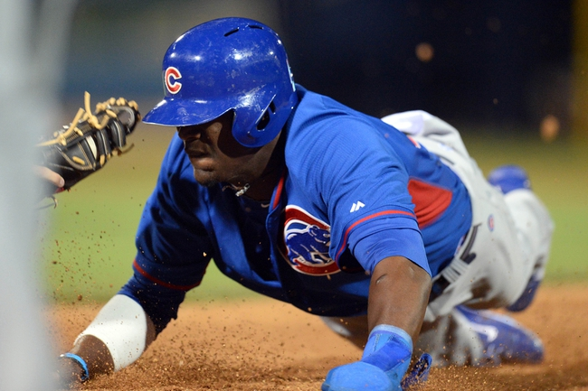 Mar 12, 2014; Peoria, AZ, USA; Chicago Cubs left fielder Junior Lake (21) is tagged out during a run down in the first inning against the Seattle Mariners at Peoria Sports Complex. Mandatory Credit: Joe Camporeale-USA TODAY Sports