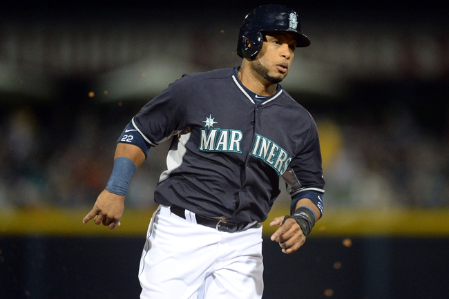 Mar 12, 2014; Peoria, AZ, USA; Seattle Mariners second baseman Robinson Cano (22) runs to third base against the Chicago Cubs in the first inning at Peoria Sports Complex. Mandatory Credit: Joe Camporeale-USA TODAY Sports