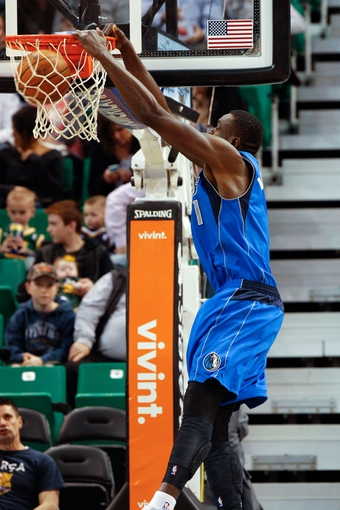 Mar 12, 2014; Salt Lake City, UT, USA; Dallas Mavericks center Samuel Dalembert (1) dunks against the Utah Jazz during the third quarter at EnergySolutions Arena. Mandatory Credit: Chris Nicoll-USA TODAY Sports