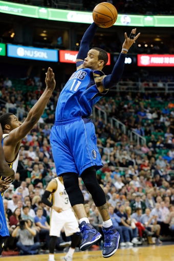 Mar 12, 2014; Salt Lake City, UT, USA; Dallas Mavericks guard Monta Ellis (11) grabs a rebound during the third quarter against the Utah Jazz at EnergySolutions Arena. Mandatory Credit: Chris Nicoll-USA TODAY Sports