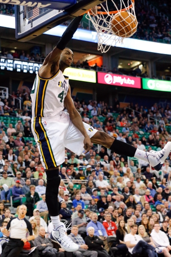 Mar 12, 2014; Salt Lake City, UT, USA; Utah Jazz forward Jeremy Evans (40) dunks during the third quarter against the Dallas Mavericks at EnergySolutions Arena. Mandatory Credit: Chris Nicoll-USA TODAY Sports