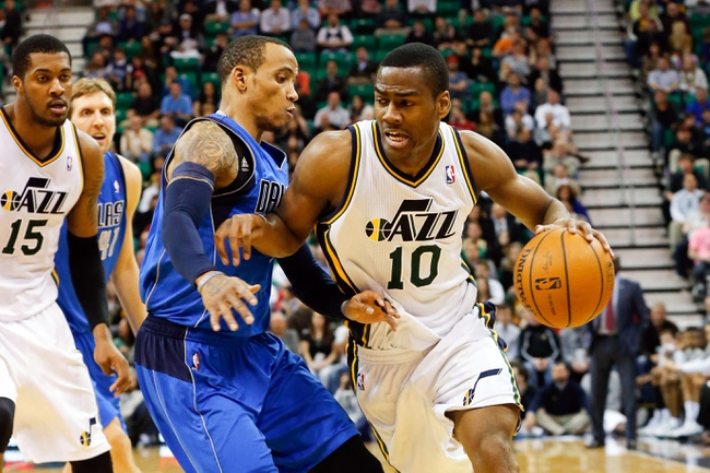 Mar 12, 2014; Salt Lake City, UT, USA; Utah Jazz guard Alec Burks (10) tries to get past Dallas Mavericks guard Monta Ellis (11) during the fourth quarter at EnergySolutions Arena. Mandatory Credit: Chris Nicoll-USA TODAY Sports