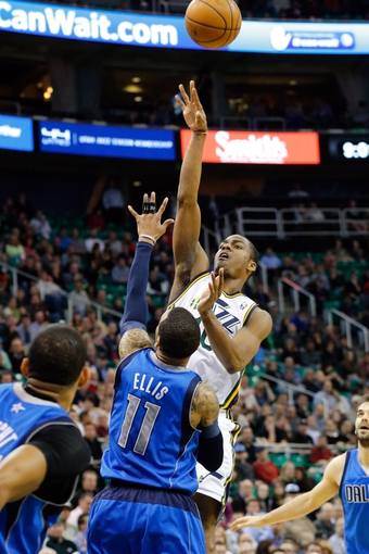 Mar 12, 2014; Salt Lake City, UT, USA; Utah Jazz guard Alec Burks (10) shoots over Dallas Mavericks guard Monta Ellis (11) during the fourth quarter at EnergySolutions Arena. Mandatory Credit: Chris Nicoll-USA TODAY Sports