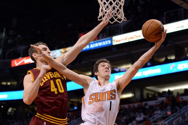 Mar 12, 2014; Phoenix, AZ, USA; Phoenix Suns guard Goran Dragic (1) lays up the ball against Cleveland Cavaliers center Tyler Zeller (40) in the second half at US Airways Center. The Cavaliers won 110-101.  Mandatory Credit: Jennifer Stewart-USA TODAY Sports