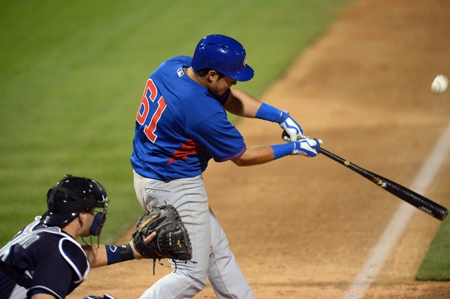Mar 12, 2014; Peoria, AZ, USA; Chicago Cubs third baseman Christian Villanueva (61) swings at a pitch against the Seattle Mariners at Peoria Sports Complex. Mandatory Credit: Joe Camporeale-USA TODAY Sports