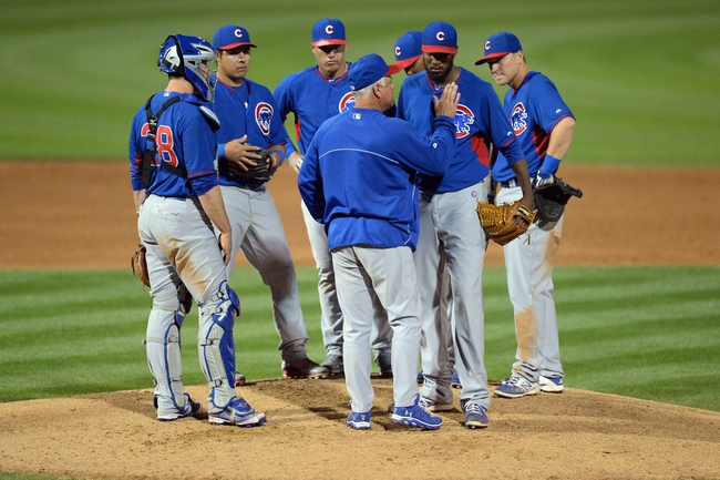 Mar 12, 2014; Peoria, AZ, USA; Chicago Cubs manager Rick Renteria (16) pulls Chicago Cubs starting pitcher James McDonald (55) from the game against the Chicago Cubs at Peoria Sports Complex. Mandatory Credit: Joe Camporeale-USA TODAY Sports