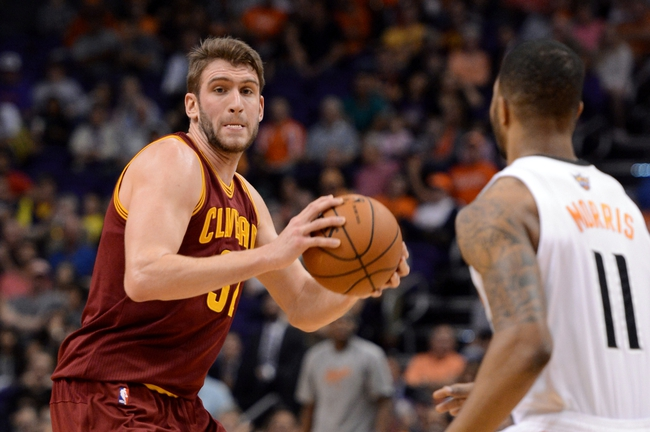 Mar 12, 2014; Phoenix, AZ, USA; Cleveland Cavaliers center Spencer Hawes (32) handles the ball against Phoenix Suns forward Markieff Morris (11) in the first half at US Airways Center. The Cavaliers won 110-101.  Mandatory Credit: Jennifer Stewart-USA TODAY Sports