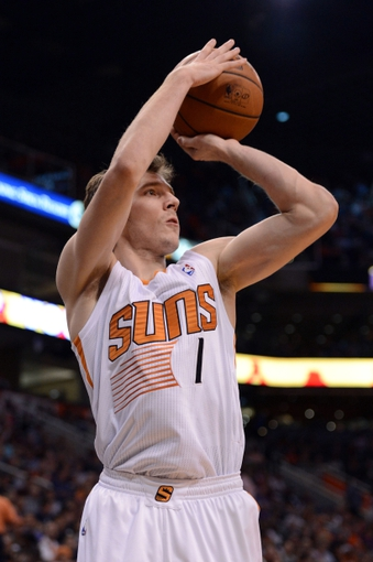Mar 12, 2014; Phoenix, AZ, USA; Phoenix Suns guard Goran Dragic (1) shoots the ball against the Cleveland Cavaliers in the second half at US Airways Center. The Cavaliers won 110-101.  Mandatory Credit: Jennifer Stewart-USA TODAY Sports