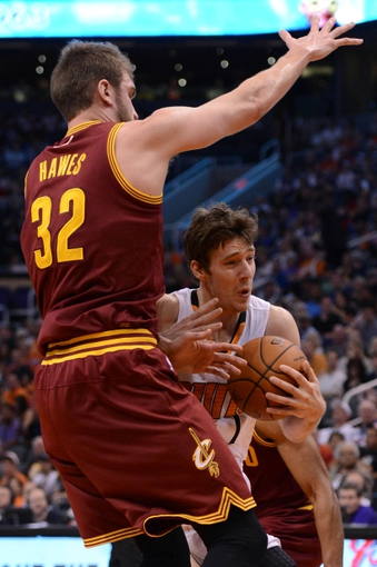 Mar 12, 2014; Phoenix, AZ, USA; Phoenix Suns guard Goran Dragic (1) drives against Cleveland Cavaliers center Spencer Hawes (32) in the second half at US Airways Center. The Cavaliers won 110-101.  Mandatory Credit: Jennifer Stewart-USA TODAY Sports
