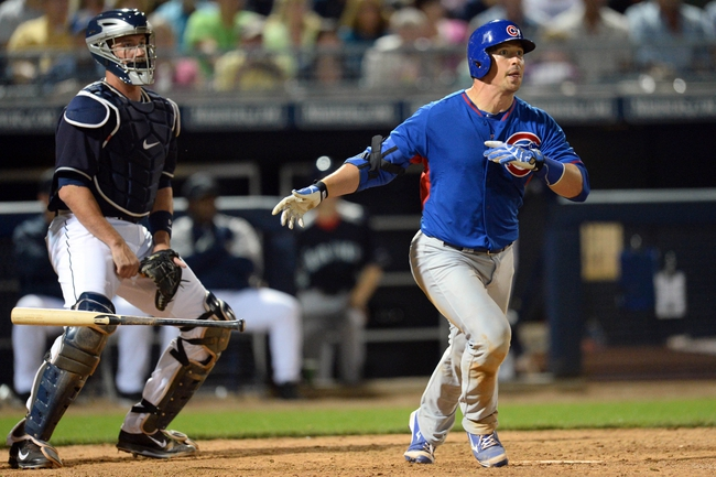 Mar 12, 2014; Peoria, AZ, USA; Chicago Cubs catcher John Baker (38) hits a three run double against the Seattle Mariners at Peoria Sports Complex. Mandatory Credit: Joe Camporeale-USA TODAY Sports
