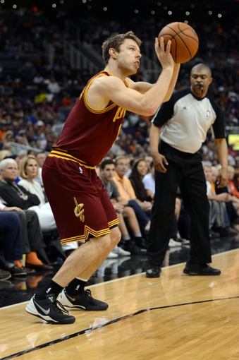 Mar 12, 2014; Phoenix, AZ, USA; Cleveland Cavaliers guard Matthew Dellavedova (8) shoots the ball against the Phoenix Suns in the first half at US Airways Center. The Cavaliers won 110-101.  Mandatory Credit: Jennifer Stewart-USA TODAY Sports