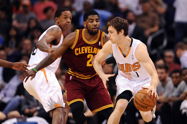 Mar 12, 2014; Phoenix, AZ, USA; Phoenix Suns guard Goran Dragic (1) handles the ball against the Cleveland Cavaliers guard Kyrie Irving (2) in the first half at US Airways Center. The Cavaliers won 110-101. Mandatory Credit: Jennifer Stewart-USA TODAY Sports