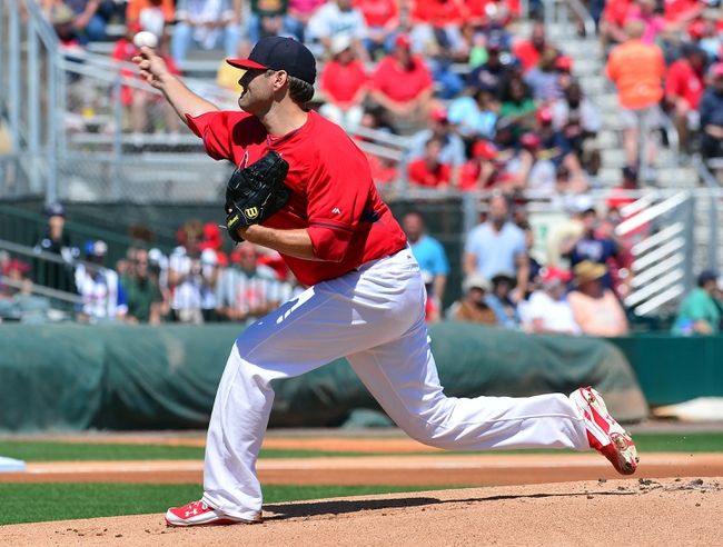 Mar 13, 2014; Jupiter, FL, USA; St. Louis Cardinals starting pitcher Lance Lynn (31) delivers a pitch against the Atlanta Braves at Roger Dean Stadium. The Cardinals defeated the Braves 11-0. Mandatory Credit: Scott Rovak-USA TODAY Sports