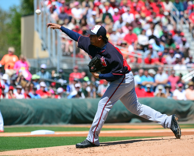 Mar 13, 2014; Jupiter, FL, USA; Atlanta Braves starting pitcher Freddy Garcia (34) delivers a pitch against the St. Louis Cardinals at Roger Dean Stadium. The Cardinals defeated the Braves 11-0. Mandatory Credit: Scott Rovak-USA TODAY Sports