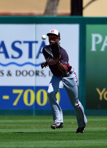 Mar 13, 2014; Jupiter, FL, USA; Atlanta Braves center fielder B.J. Upton (2) makes a catch against the St. Louis Cardinals at Roger Dean Stadium. The Cardinals defeated the Braves 11-0. Mandatory Credit: Scott Rovak-USA TODAY Sports