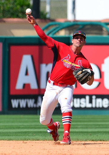 Mar 13, 2014; Jupiter, FL, USA; St. Louis Cardinals second baseman Greg Garcia (79) throws out a Atlanta Braves base runner at Roger Dean Stadium. The Cardinals defeated the Braves 11-0. Mandatory Credit: Scott Rovak-USA TODAY Sports