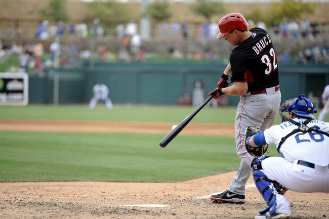 Mar 13, 2014; Phoenix, AZ, USA; Cincinnati Reds right fielder Jay Bruce (32) swings at a pitch against the Los Angeles Dodgers during a spring training game at Camelback Ranch. Mandatory Credit: Joe Camporeale-USA TODAY Sports
