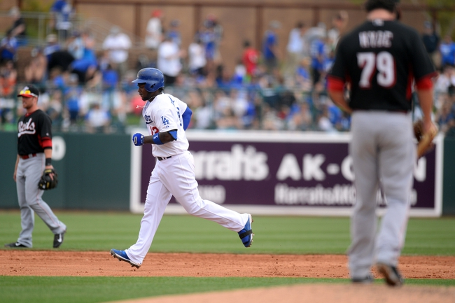 Mar 13, 2014; Phoenix, AZ, USA; Los Angeles Dodgers shortstop Hanley Ramirez (13) runs the bases after hitting a solo home run against Cincinnati Reds relief pitcher Lee Hyde (79) in the fifth inning of a spring training game at Camelback Ranch. Mandatory Credit: Joe Camporeale-USA TODAY Sports