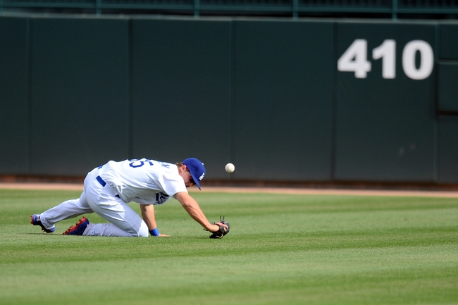 Mar 13, 2014; Phoenix, AZ, USA; Los Angeles Dodgers left fielder Joc Pederson (65) is unable to catch a line drive in the eighth inning of a spring training game against the Cincinnati Reds at Camelback Ranch. Mandatory Credit: Joe Camporeale-USA TODAY Sports