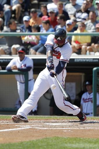 Mar 14, 2014; Lake Buena Vista, FL, USA; Atlanta Braves right fielder Jason Heyward (22) hits a RBI single during the fifth inning against the Tampa Bay Rays at Champion Stadium. Mandatory Credit: Kim Klement-USA TODAY Sports