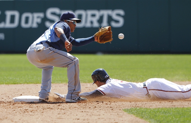 Mar 14, 2014; Lake Buena Vista, FL, USA; Atlanta Braves shortstop Andrelton Simmons (19) steals second base as Tampa Bay Rays shortstop Ray Olmedo (69) catches the ball during the fifth inning at Champion Stadium. Mandatory Credit: Kim Klement-USA TODAY Sports