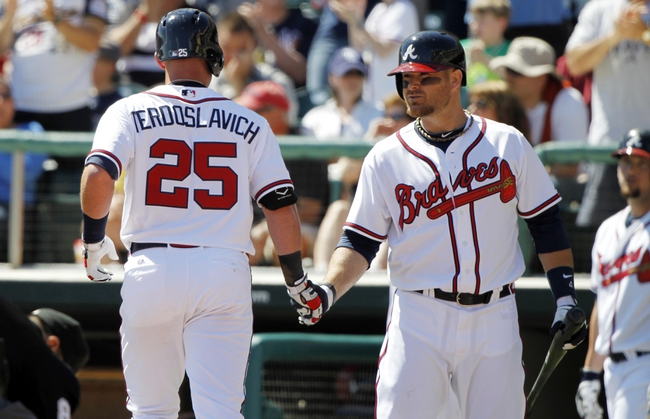 Mar 14, 2014; Lake Buena Vista, FL, USA; Atlanta Braves left fielder Joey Terdoslavich (25) is congratulated by catcher Ryan Doumit (4) after he hit a home run during the sixth inning against the Tampa Bay Rays at Champion Stadium. Mandatory Credit: Kim Klement-USA TODAY Sports