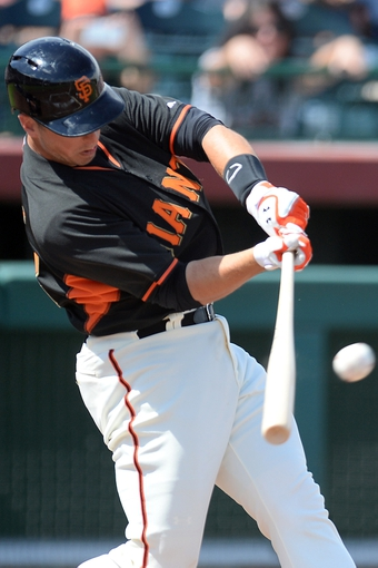 Mar 14, 2014; Scottsdale, AZ, USA; San Francisco Giants catcher Buster Posey (28) swings at a pitch against the Colorado Rockies in the first inning at Scottsdale Stadium. Mandatory Credit: Joe Camporeale-USA TODAY Sports