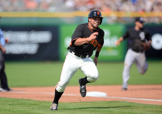 Mar 14, 2014; Scottsdale, AZ, USA; San Francisco Giants center fielder Juan Perez (2) rounds third base and scores a run in the fourth inning against the Colorado Rockies at Scottsdale Stadium. Mandatory Credit: Joe Camporeale-USA TODAY Sports