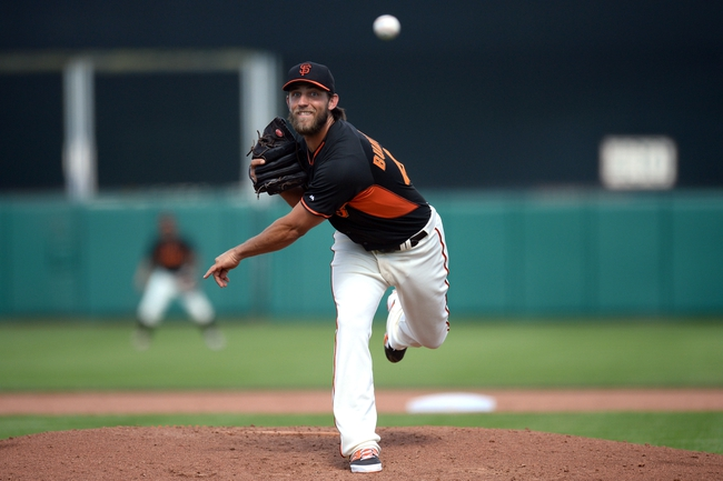 Mar 14, 2014; Scottsdale, AZ, USA; San Francisco Giants starting pitcher Madison Bumgarner (40) pitches in the fifth inning against the Colorado Rockies at Scottsdale Stadium. Mandatory Credit: Joe Camporeale-USA TODAY Sports