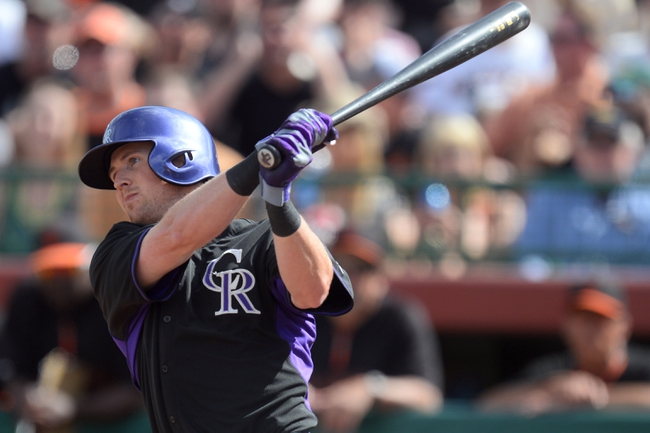 Mar 14, 2014; Scottsdale, AZ, USA; Colorado Rockies catcher Matt McBride (7) follows through on a swing in the sixth inning against the San Francisco Giants at Scottsdale Stadium. Mandatory Credit: Joe Camporeale-USA TODAY Sports