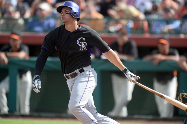 Mar 14, 2014; Scottsdale, AZ, USA; Colorado Rockies third baseman Nolan Arenado (28) follows through on a swing in the sixth inning against the San Francisco Giants at Scottsdale Stadium. Mandatory Credit: Joe Camporeale-USA TODAY Sports