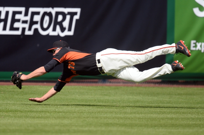 Mar 14, 2014; Scottsdale, AZ, USA; San Francisco Giants relief pitcher David Huff (78) makes a diving catch in the sixth inning against the Colorado Rockies at Scottsdale Stadium. Mandatory Credit: Joe Camporeale-USA TODAY Sports