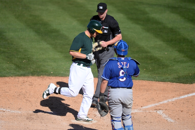 Mar 15, 2014; Phoenix, AZ, USA; Oakland Athletics first baseman Brandon Moss (37) crosses home plate after hitting a home run in the fifth inning against the Texas Rangers at Phoenix Municipal Stadium. Mandatory Credit: Joe Camporeale-USA TODAY Sports