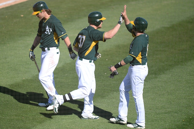 Mar 15, 2014; Phoenix, AZ, USA; Oakland Athletics first baseman Brandon Moss (37) celebrates with teammates after hitting a home run in the fifth inning against the Texas Rangers at Phoenix Municipal Stadium. Mandatory Credit: Joe Camporeale-USA TODAY Sports
