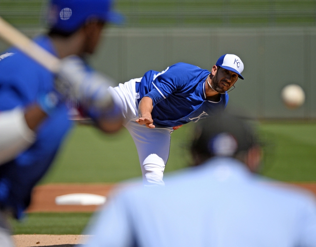 Mar 15, 2014; Surprise, AZ, USA; Kansas City Royals pitcher James Shileds (33) throws during the first inning against the Chicago Cubs at Surprise Stadium. Mandatory Credit: Christopher Hanewinckel-USA TODAY Sports