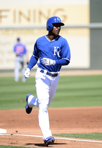 Mar 15, 2014; Surprise, AZ, USA; Kansas City Royals center fielder Jarrod Dyson (1) runs the bases after a leadoff solo home run during the first inning against the Chicago Cubs at Surprise Stadium. Mandatory Credit: Christopher Hanewinckel-USA TODAY Sports