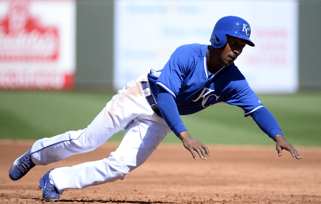 Mar 15, 2014; Surprise, AZ, USA; Kansas City Royals center fielder Jarrod Dyson (1) dives back to first base during the third inning against the Chicago Cubs at Surprise Stadium. Mandatory Credit: Christopher Hanewinckel-USA TODAY Sports