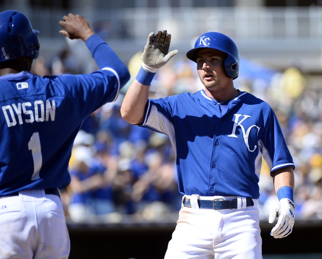 Mar 15, 2014; Surprise, AZ, USA; Kansas City Royals second baseman Johnny Giavotella (9) is congratulated by center fielder Jarrod Dyson (1) after a two-run home run during the third inning against the Chicago Cubs at Surprise Stadium. Mandatory Credit: Christopher Hanewinckel-USA TODAY Sports