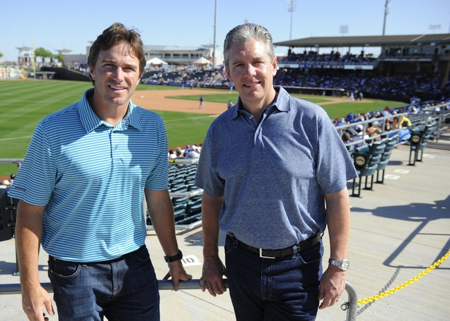 Mar 15, 2014; Surprise, AZ, USA; Sports agent Casey Close (right) and colleague David O'Hagan during the Kansas City Royals spring training game against the Chicago Cubs at Surprise Stadium. Mandatory Credit: Christopher Hanewinckel-USA TODAY Sports