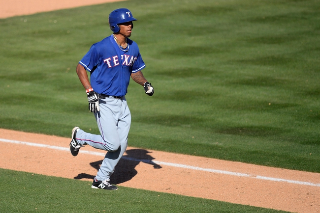 Mar 15, 2014; Phoenix, AZ, USA; Texas Rangers outfielder Nick Williams (46) runs the bases after hitting a home run against the Oakland Athletics at Phoenix Municipal Stadium. Mandatory Credit: Joe Camporeale-USA TODAY Sports