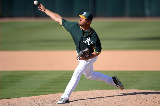 Mar 15, 2014; Phoenix, AZ, USA; Oakland Athletics relief pitcher Deryk Hooker (71) pitches against the Texas Rangers in the ninth inning at Phoenix Municipal Stadium. The Rangers won 16-15. Mandatory Credit: Joe Camporeale-USA TODAY Sports