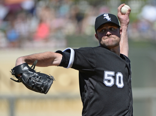 Mar 16, 2014; Surprise, AZ, USA; Chicago White Sox pitcher John Danks (50) throws during the first inning against the Texas Rangers at Surprise Stadium. Mandatory Credit: Christopher Hanewinckel-USA TODAY Sports