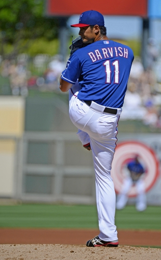 Mar 16, 2014; Surprise, AZ, USA; Texas Rangers pitcher Yu Darvish (11) throws during the first inning against the Chicago White Sox at Surprise Stadium. Mandatory Credit: Christopher Hanewinckel-USA TODAY Sports