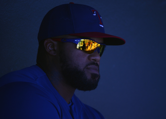 Mar 16, 2014; Surprise, AZ, USA; Texas Rangers first baseman Prince Fielder (84) on the bench prior to the game against the Chicago White Sox at Surprise Stadium. Mandatory Credit: Christopher Hanewinckel-USA TODAY Sports