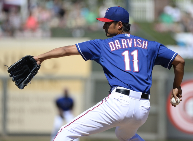 Mar 16, 2014; Surprise, AZ, USA; Texas Rangers pitcher Yu Darvish (11) throws during the second inning against the Chicago White Sox at Surprise Stadium. Mandatory Credit: Christopher Hanewinckel-USA TODAY Sports