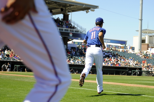 Mar 16, 2014; Surprise, AZ, USA; Texas Rangers pitcher Yu Darvish (11) takes the field for the first inning against the Chicago White Sox at Surprise Stadium. Mandatory Credit: Christopher Hanewinckel-USA TODAY Sports