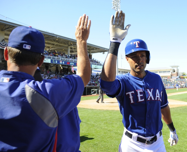 Mar 16, 2014; Surprise, AZ, USA; Texas Rangers right fielder Alex Rios (51) is congratulated after a solo home run during the sixth inning against the Chicago White Sox at Surprise Stadium. Mandatory Credit: Christopher Hanewinckel-USA TODAY Sports