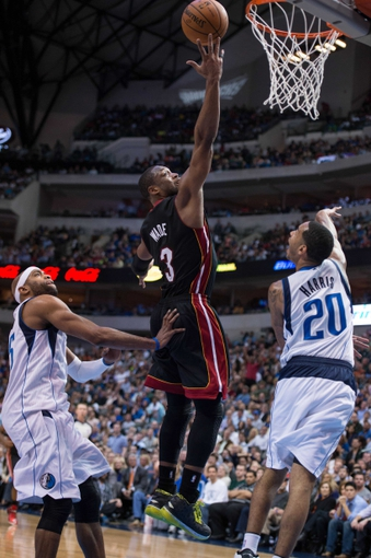 Feb 18, 2014; Dallas, TX, USA; Miami Heat shooting guard Dwyane Wade (3) during the game against the Dallas Mavericks at the American Airlines Center. The Heat defeated the Mavericks  117-106. Mandatory Credit: Jerome Miron-USA TODAY Sports